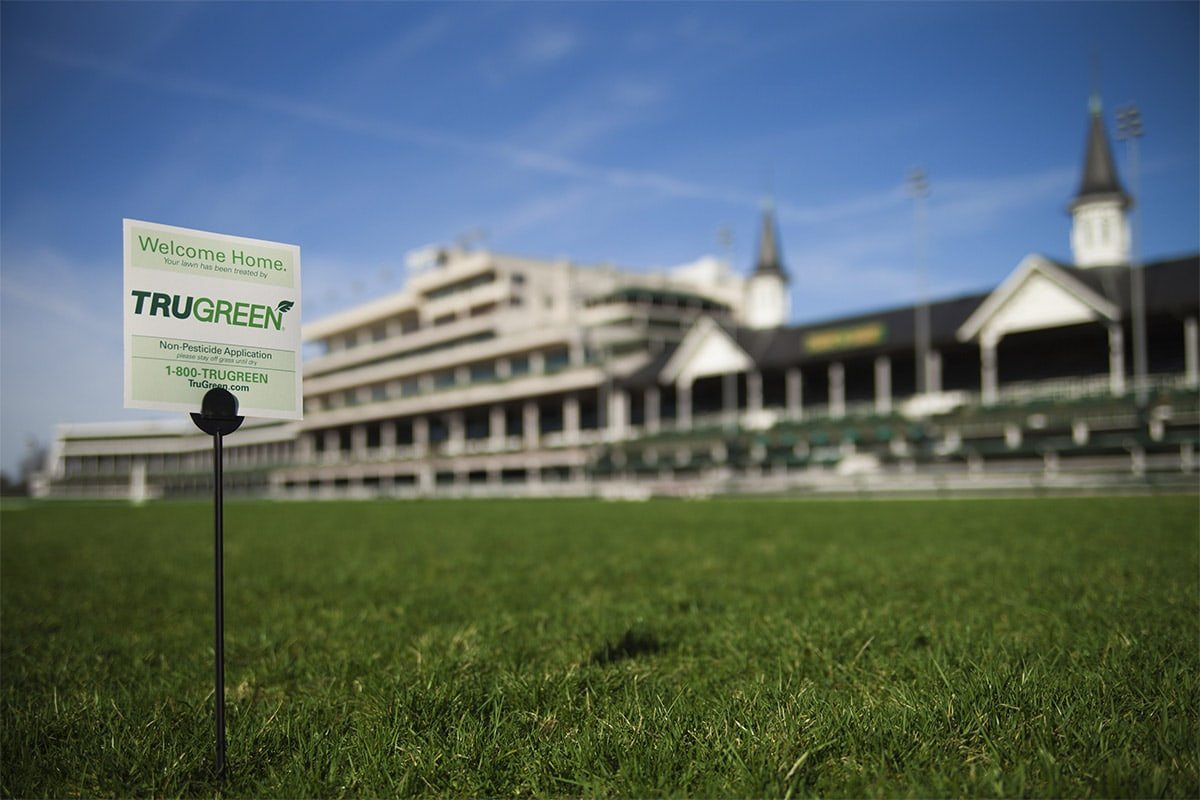 <p>TruGreen Sign with Churchill Downs in the background</p>