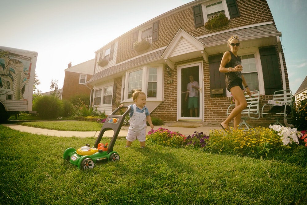 <p>Family enjoys a TruGreen lawn at their new home</p>