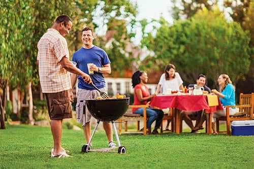 <p>A summer bbq on a healthy TruGreen lawn</p>