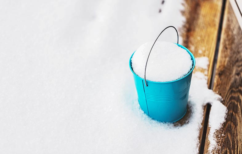 Bucket covered in snow
